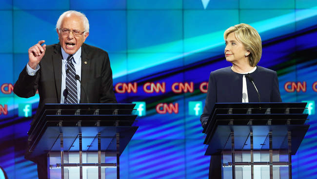 Candidates Bernie Sanders and Hillary Clinton debate on topics they will face as presidents.