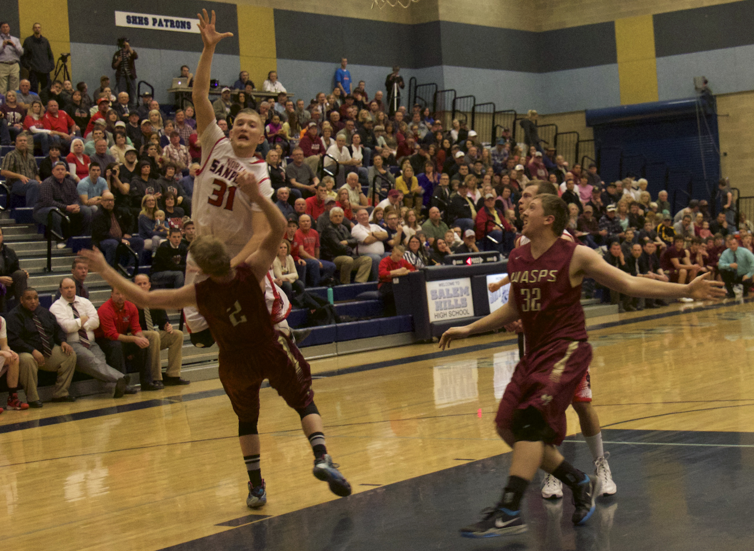 Senior Dakota Anderson (31) goes up for a layup as a Juab defender tries to draw the charge. NS fell to the Wasps, 60-57 in overtime.